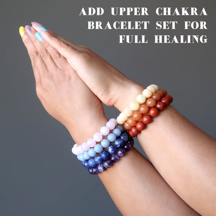 hands wearing the upper and the lower chakra bracelet sets