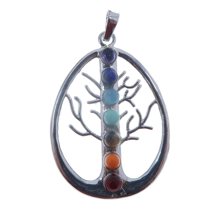 silver pear shape pendant with cut out tree design lined with 7 chakra gemstones