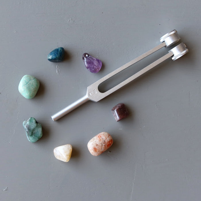 7 chakra stones and tuning fork set with amethyst, apatite, amazonite, emeral, citrine, sunstone, ruby