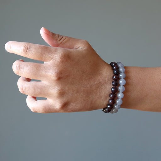 female hand modeling faceted gray and brown chalcedony beaded stretch bracelet set