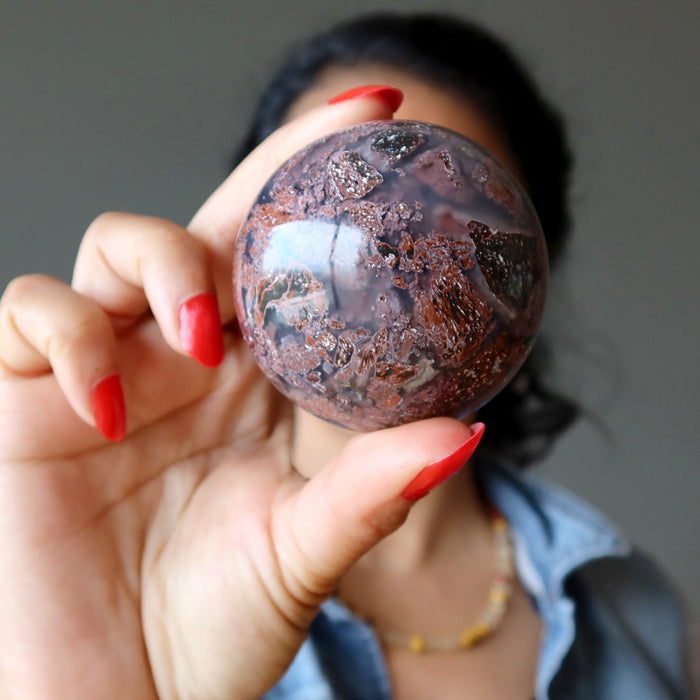 sheila of satin crystals holding up a chalcedony jasper crystal ball