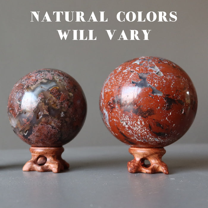 chalcedony jasper crystal balls on fancy wood display stands showing natural colors vary