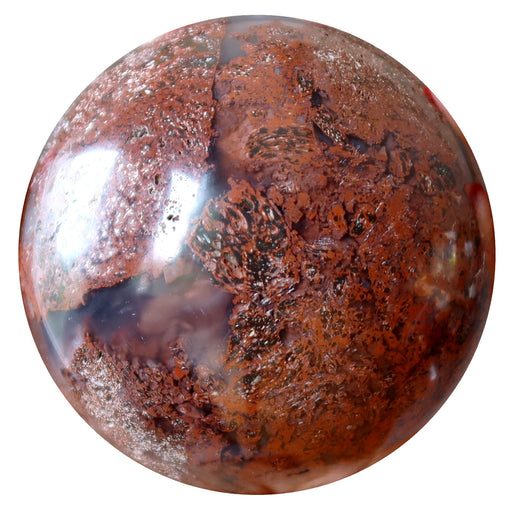 red jasper floating in translucent chalcedony polished into a crystal ball sphere
