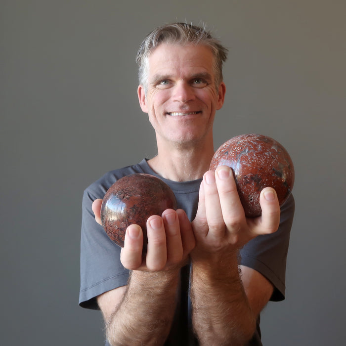 ryan of satin crystals holding two chalcedony spheres