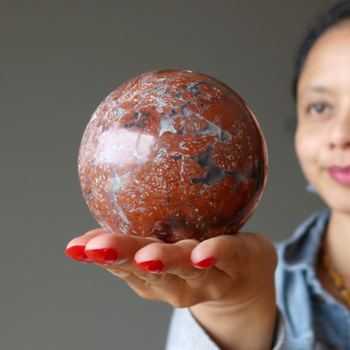 sheila of satin crystals gazing at a chalcedony jasper crystal ball
