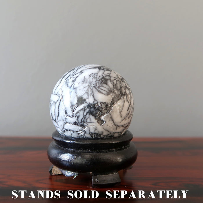 chrysanthemum stone ball on wood display stand