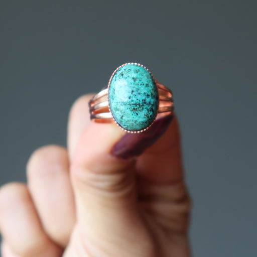 hand holding chrysocolla copper ring