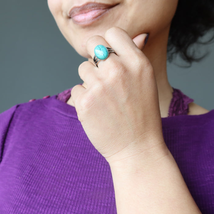 hand wearing chrysocolla gunmetal ring