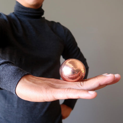 balancing a copper sphere on the back of the hand
