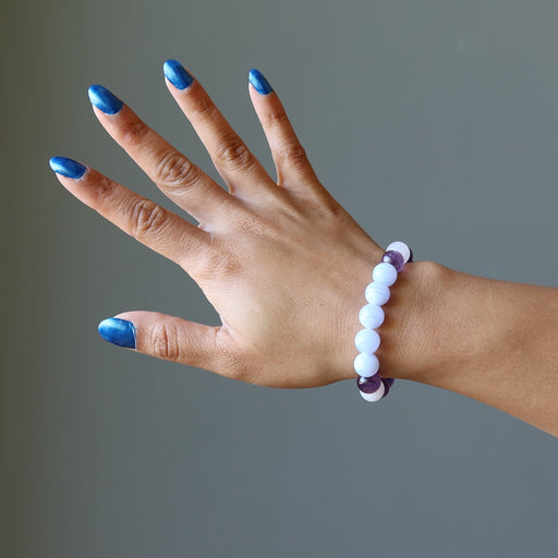 hand wearing blue lace agate, rose quartz, amethyst stretch bracelet for sleep