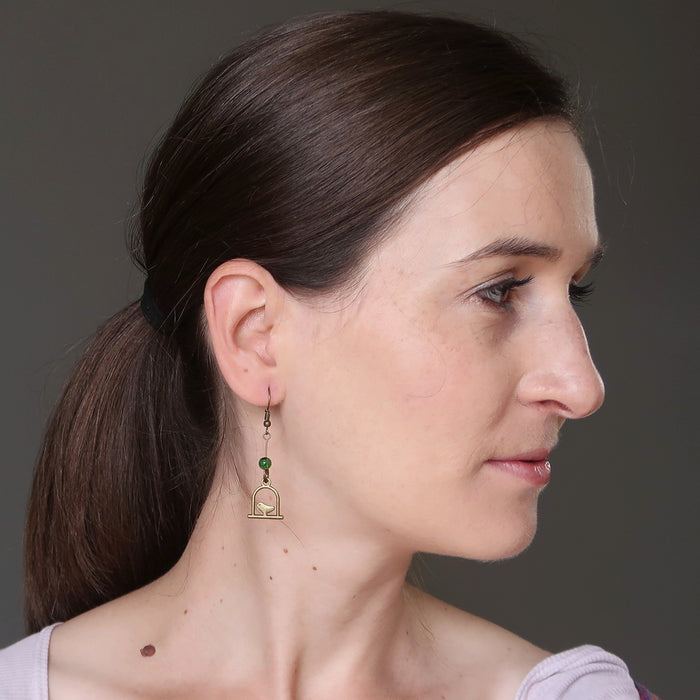 liz of satin crystals wearing green diopside on birdcage dangle earrings