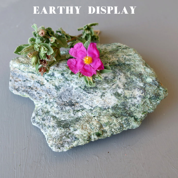 rough green epidote standing mineral stone with pink flowers