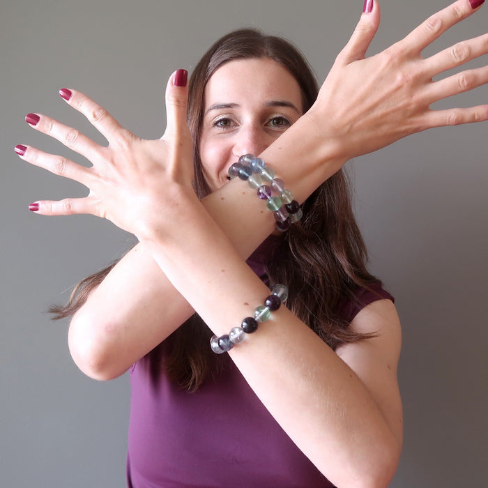 lucia of satin crystals wearing rainbow fluorite beaded stretch bracelets