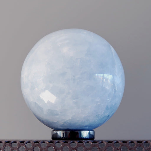 blue calcite sphere on hematine ring stand