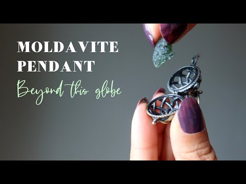 video featuring a moldavite pendant