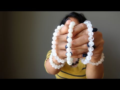 video about white rainbow moonstone beaded stretch bracelets