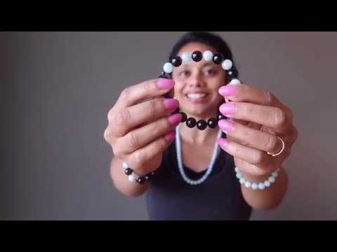 video on wearing blue aquamarine and black rainbow obsidian stretch bracelet