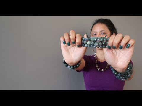video about wearing green and white moss agate round beaded stretch bracelets