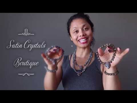 video on wearing faceted labradorite and wolf head beaded stretch bracelets