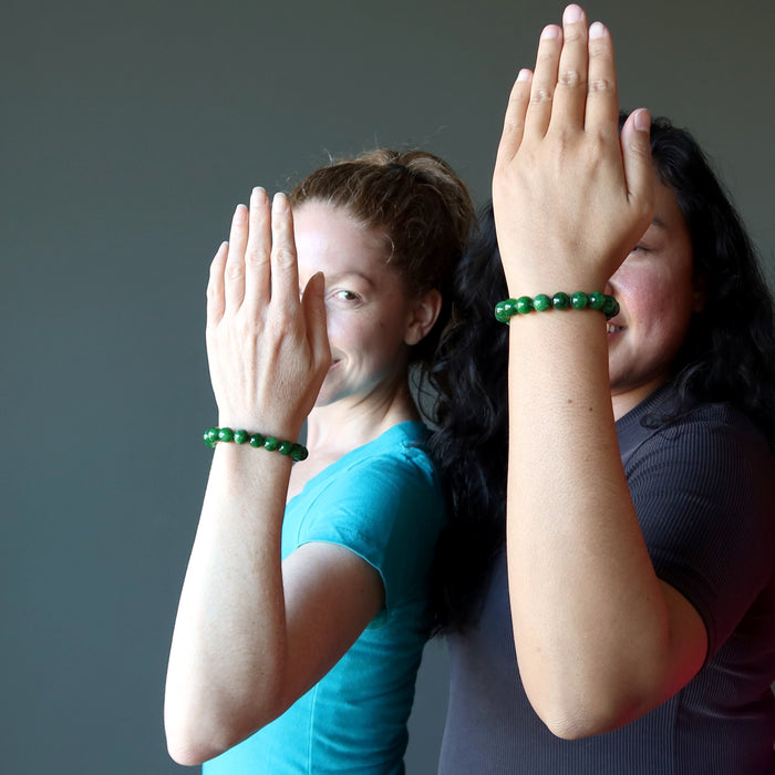 two female models wearing bright green jade round beaded bracelet