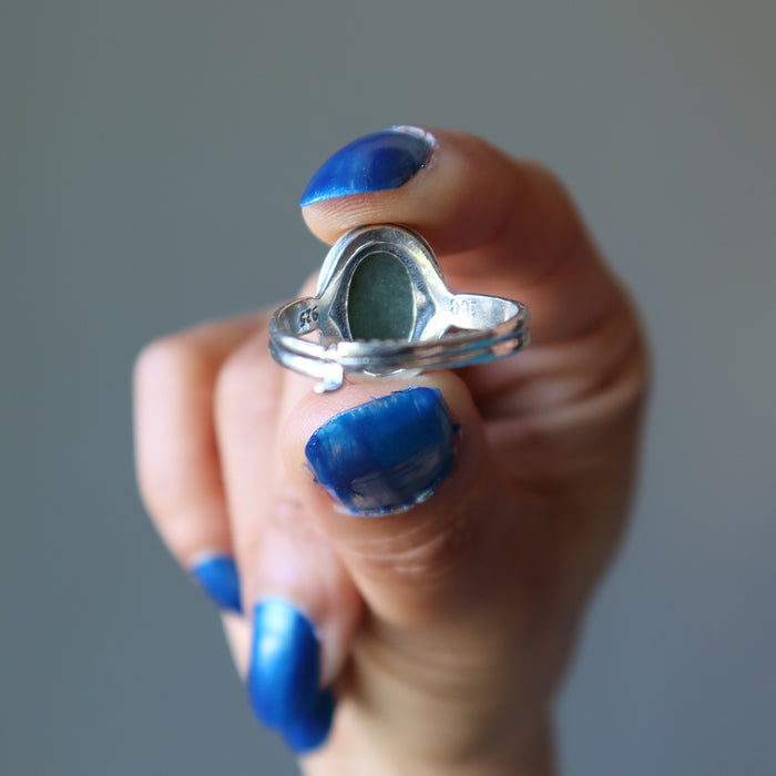 showing the back of nephrite jade oval in sterling silver ring
