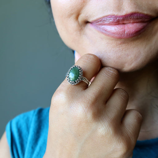 nephrite jade oval in sterling silver ring on hand on chin