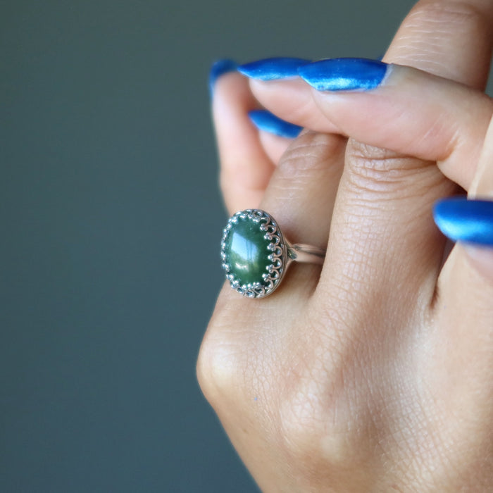 hand wearing nephrite jade oval in sterling silver ring