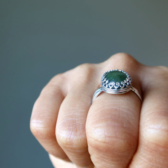 finger wearing nephrite jade oval in sterling silver ring