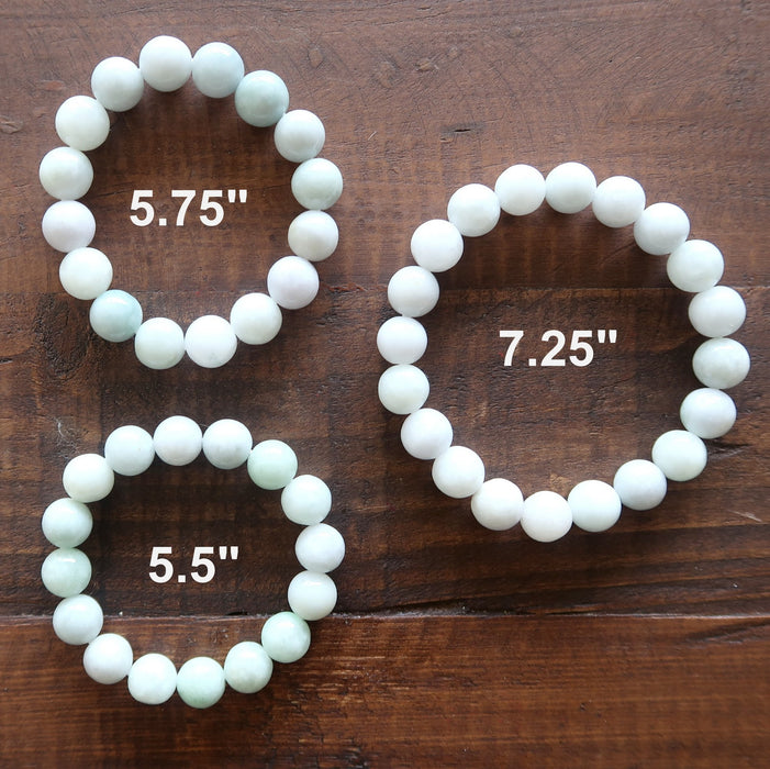 3 white jade round beaded stretch bracelets showing different lengths