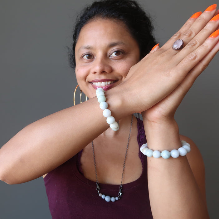 sheila of satin crystals wearing white jade round beaded stretch bracelet on each wrist