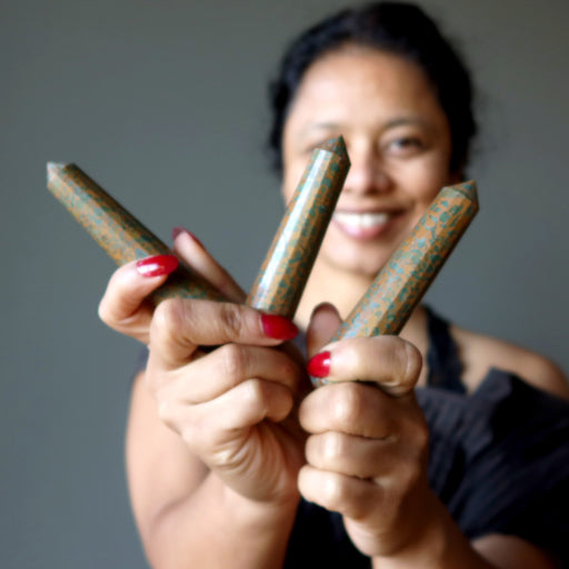 sheila of satin crystals holding three jasper wands