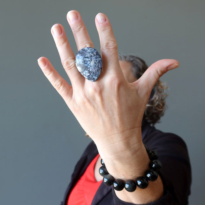 female wearing a big dendritic jasper ring