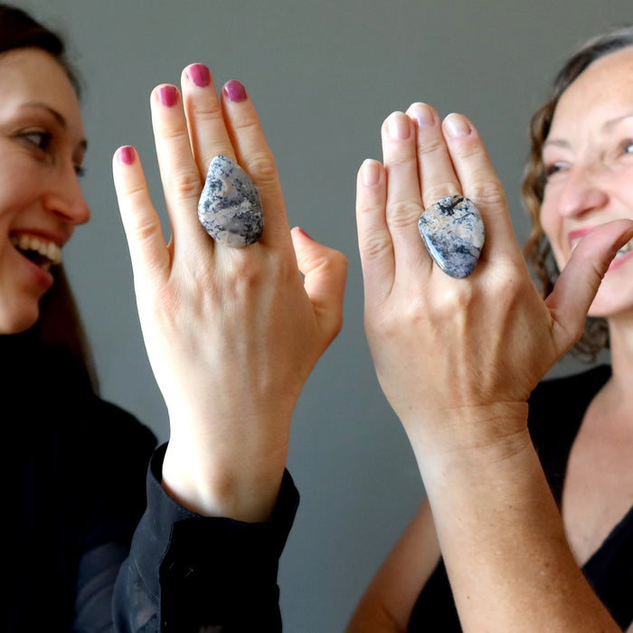 two females wearing a big dendritic jasper ring