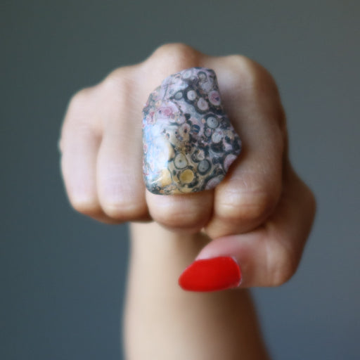 fist wearing leopard jasper ring