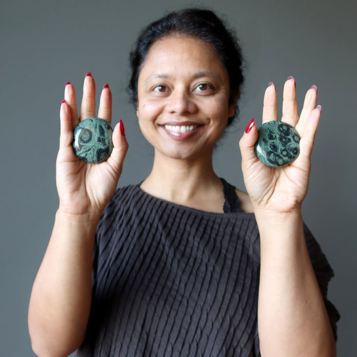 sheila of satin crystals holding set of kambaba jasper polished stones in each palm