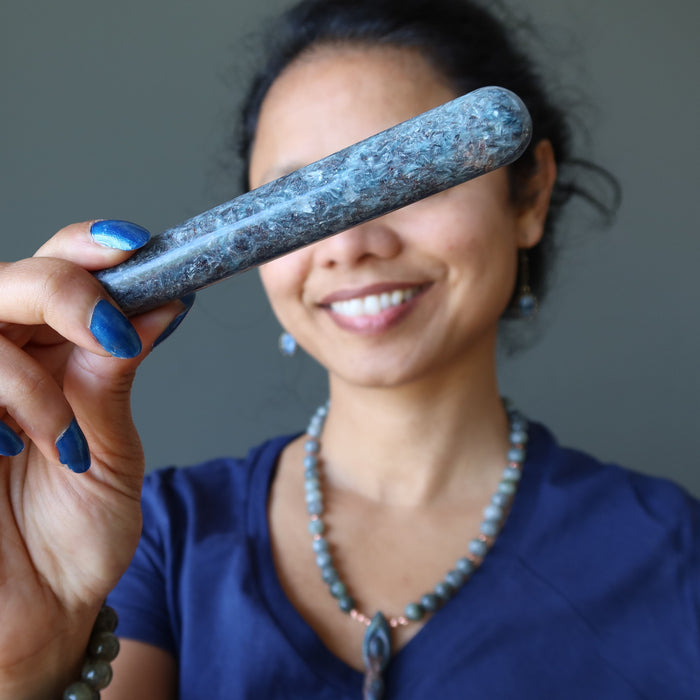 sheila of satin crystals holding up a blue kyanite massage wand