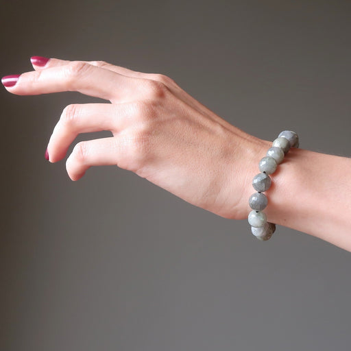 hand wearing faceted labradorite beaded stretch bracelet