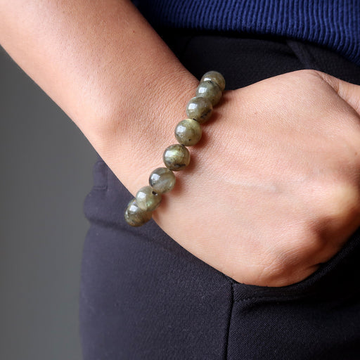 hand in pants pocket wearing round labradorite beaded stretch bracelet