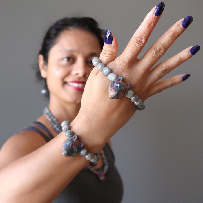 sheila of satin crystals wearing two faceted labradorite and wolf head beaded stretch bracelets