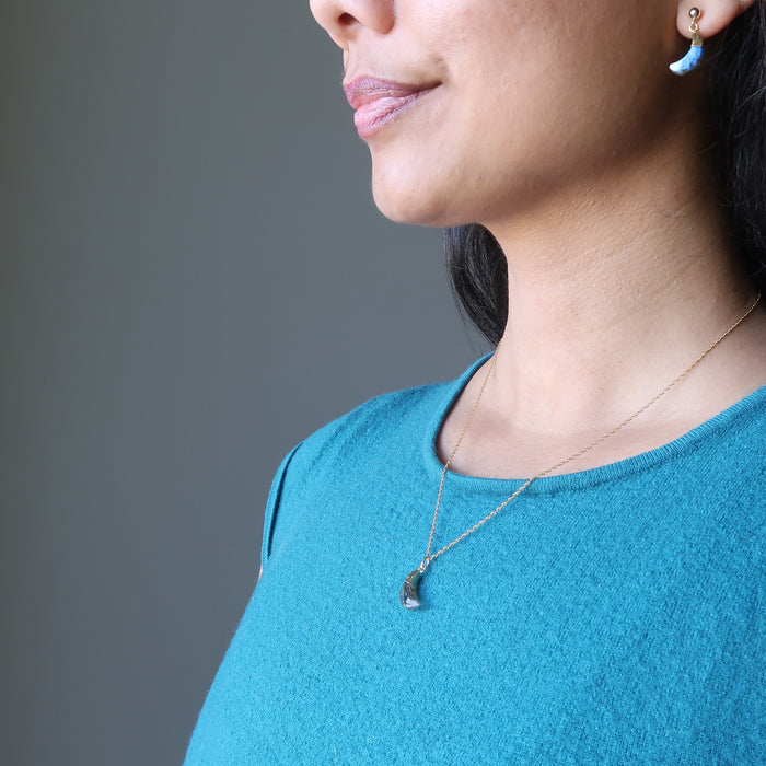 sheila of satin crystals wearing faceted labradorite crescent moon gold chain necklace