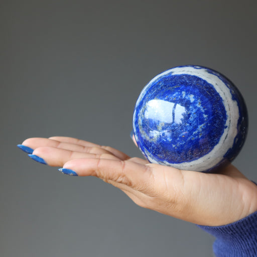 hand holding 3 inch lapis lazuli sphere