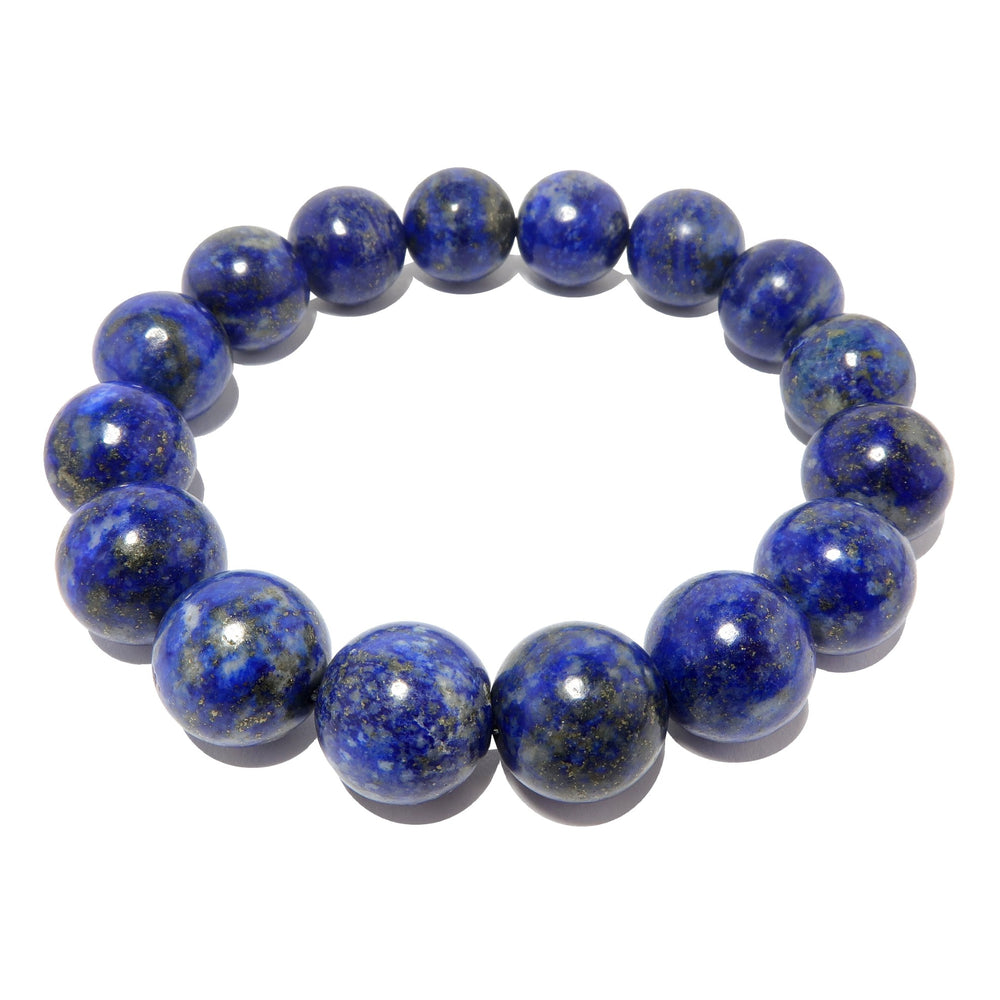 genuine blue lapis lazuli stretch bracelet beaded with natural round beads on elastic cord, handmade at satin crystals studio.