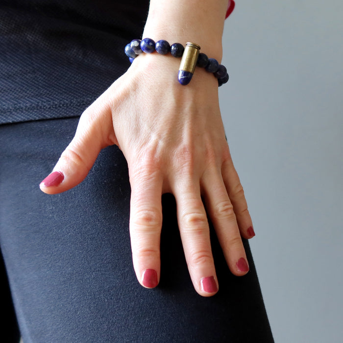 hand on leg wearing a lapis peace bullet stretch bracelet