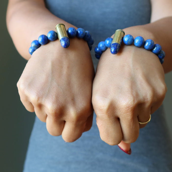 two wrists wearing lapis peace bullet stretch bracelets