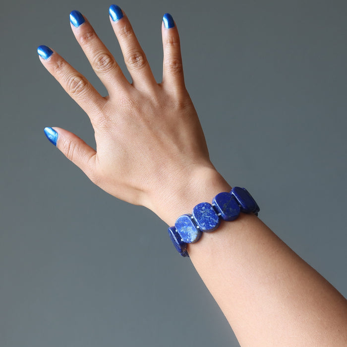 hand wearing rounded rectangle lapis beaded stretch bracelet