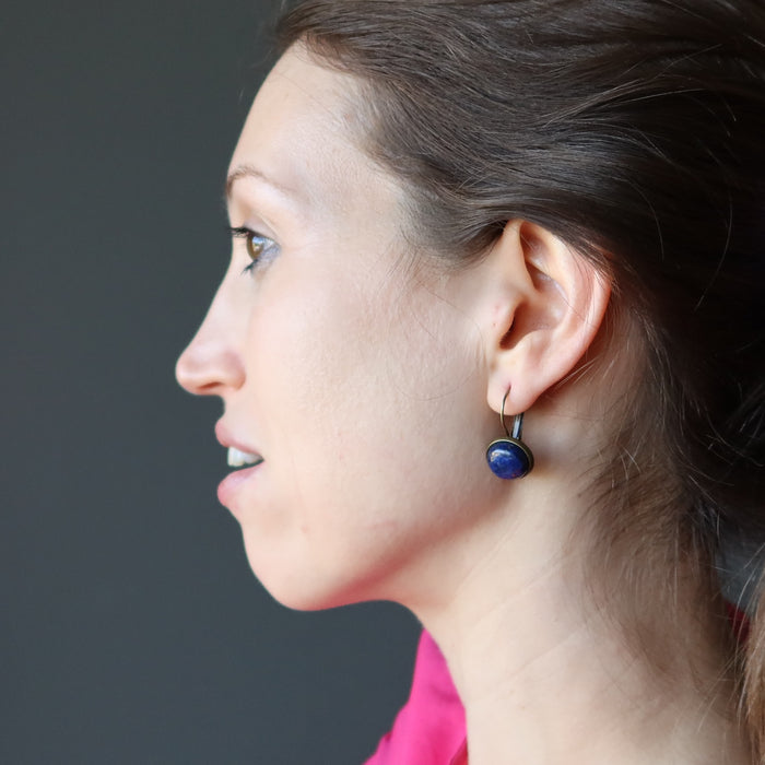 wearing round lapis lazuli in antique bronze leverback earrings