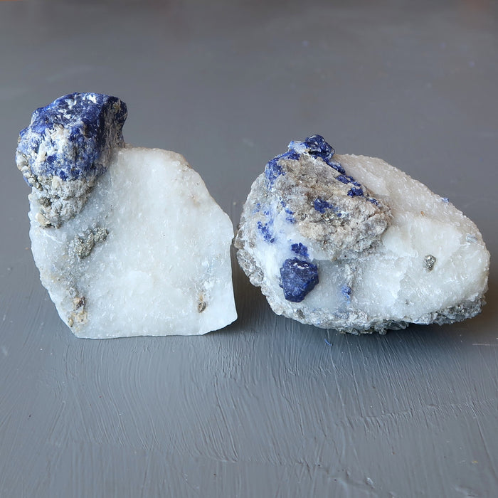 pair of  blue lazurite and gold pyrite on white calcite raw mineral