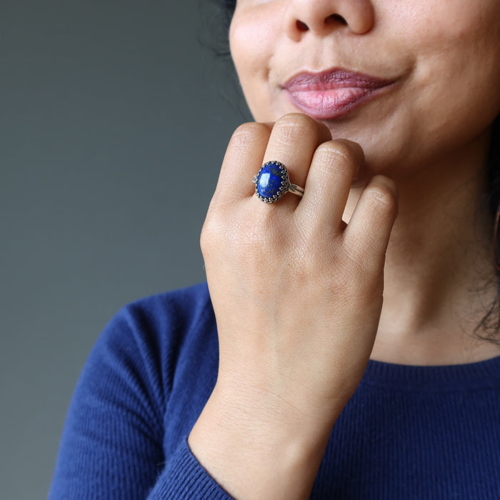 hand on chin wearing lapis lazuli sterling silver ring adjustable jewelry