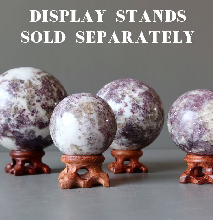 lepidolite balls on wood stands which are sold separately