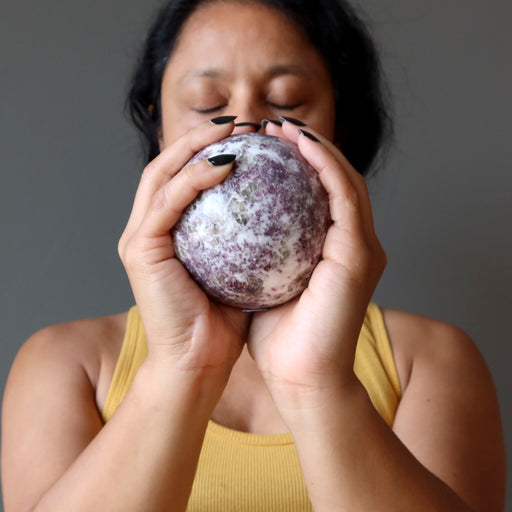 sheila of satin crystals meditating with a quartz lepidolite sphere